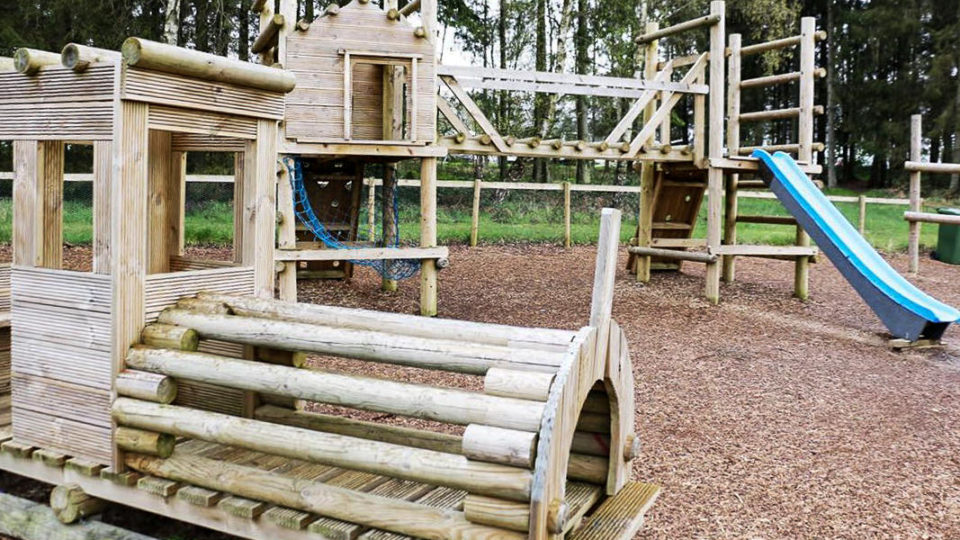 Lodge Coppice's rustic, wooden playground.