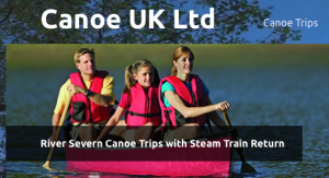 A man, a lady and a child are all wearing red life vests whilst paddling in a canoe on the river Severn.